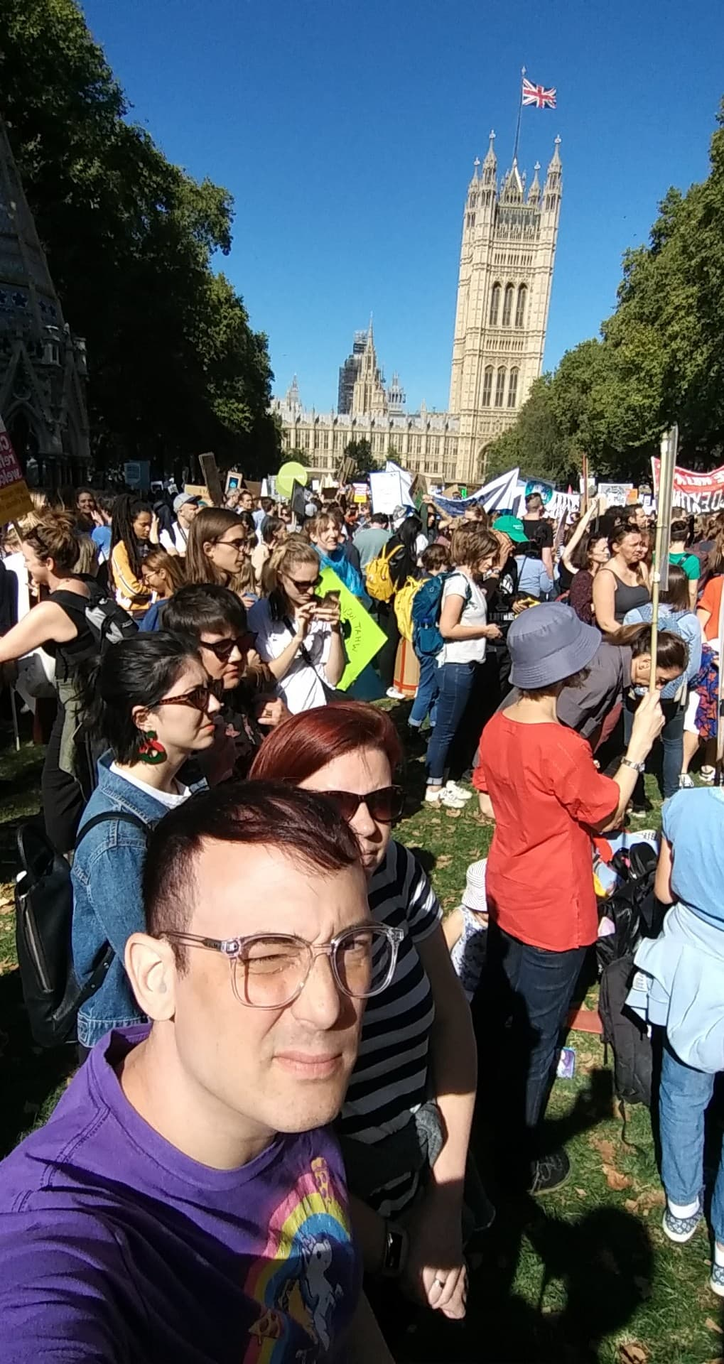 Ean and Victoria standing amongst thousands of climate change protesters